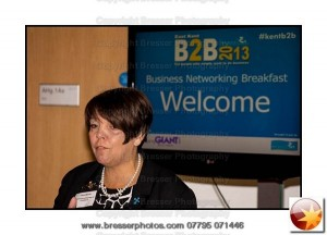 Carole Baron from Kent Invicta Chamber of Commerce speaking in front of LCD monitor