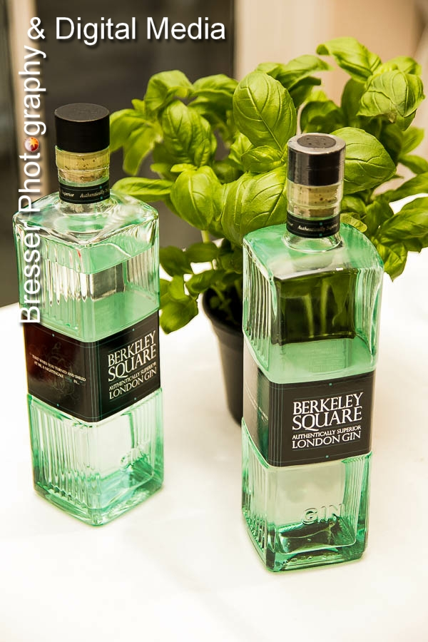 Berkerley Square branded gin bottles with basil plant in the background