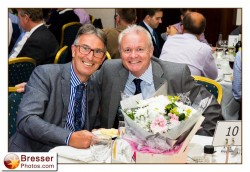 Two men enjoy their company during dinner event
