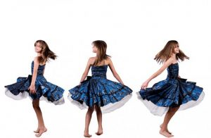 girl twirling in three aspects