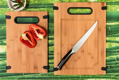 chopping board made from bamboo with a halved red pepper and cook's knife