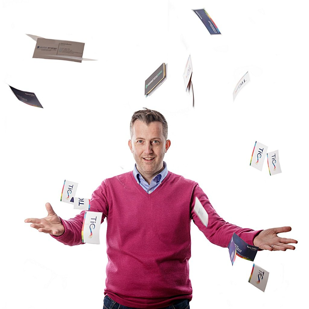 Portrait of Terry Cella, printer surrounded by 'flying' business cards. Created by Pete Bresser, photographer
