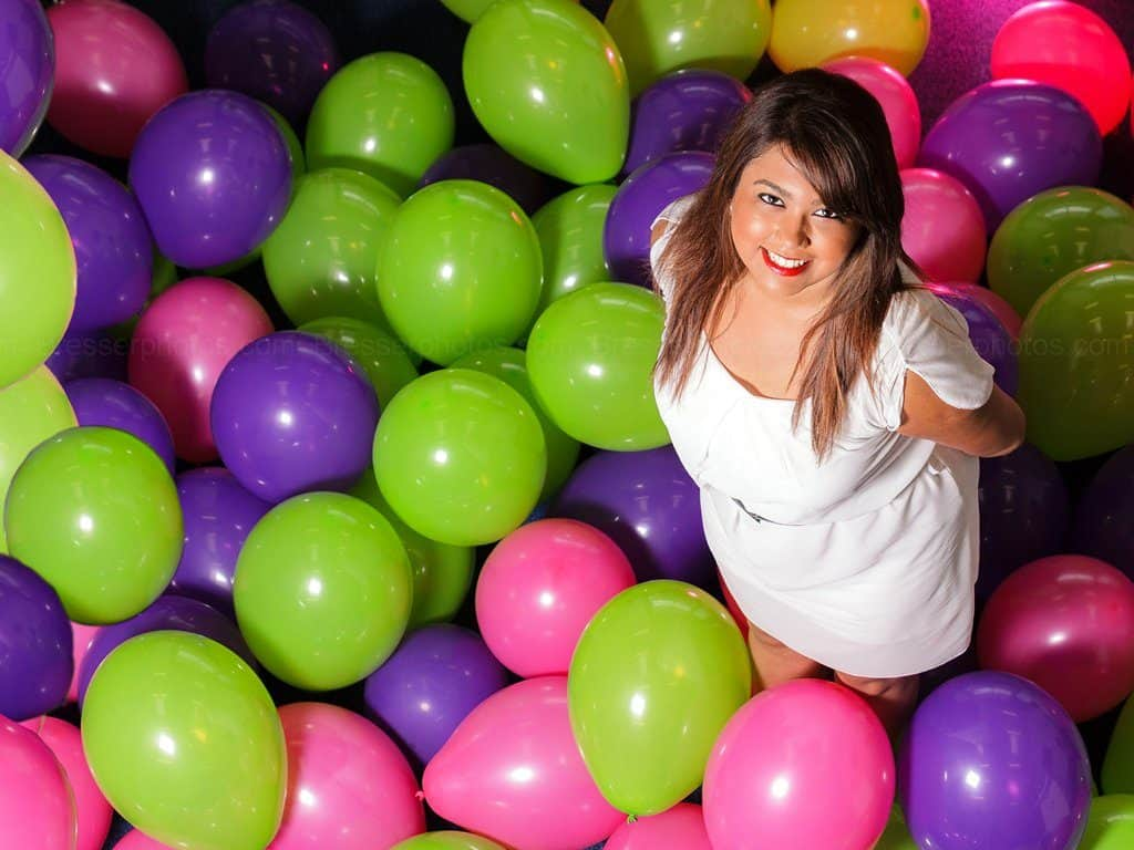 Business Portrait of a woman standing out from balloons
