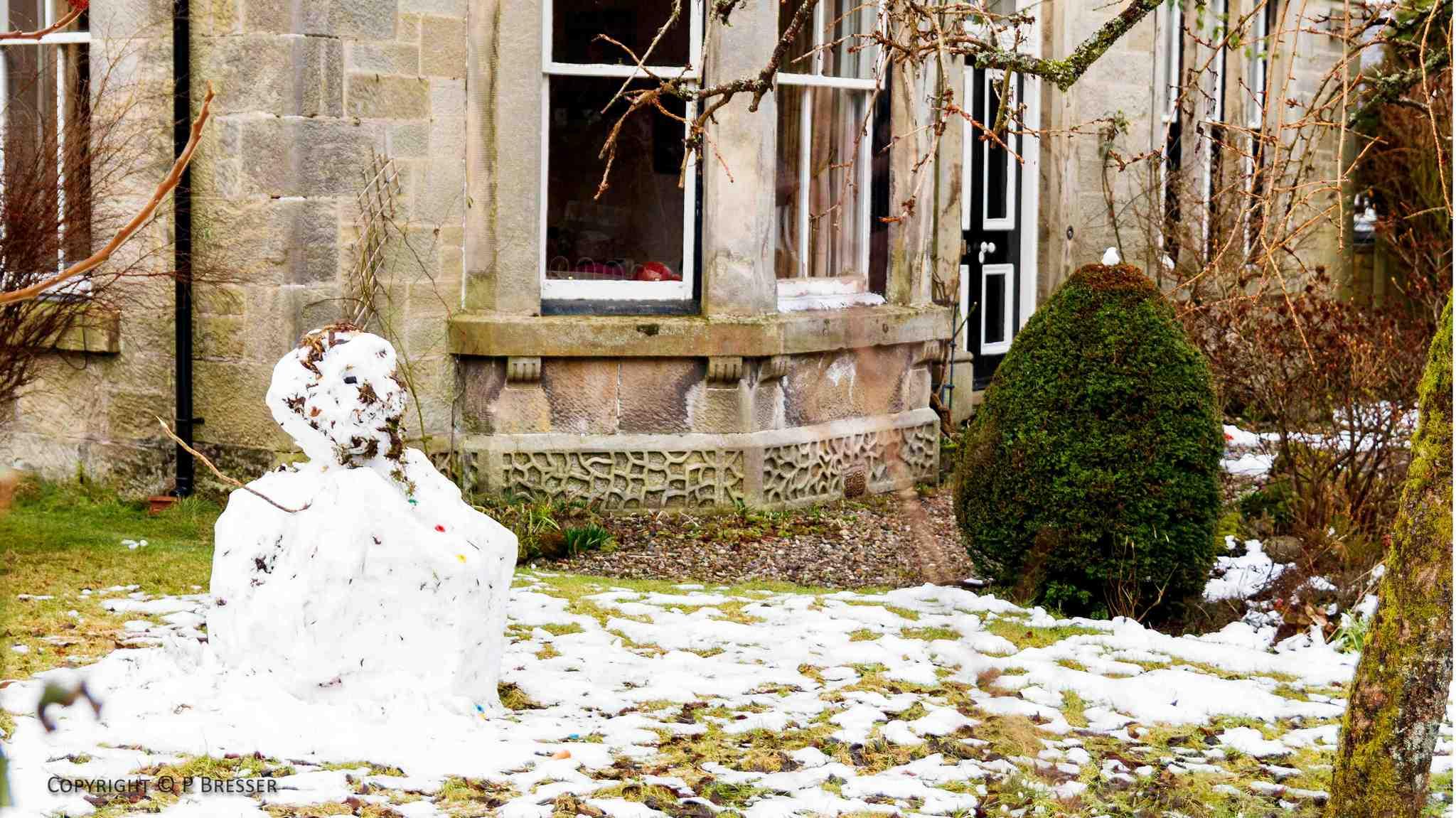 snowman in Victorian house's garden